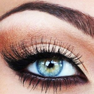 This natural smokey eye really makes your eyes pop. Check out Beauty.com for mor...