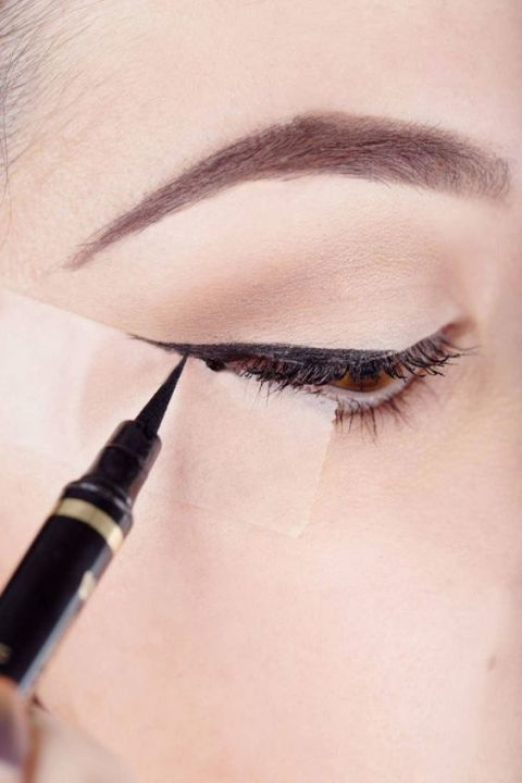 Use a small piece of scotch tape to flawlessly apply liquid eyeliner every time.