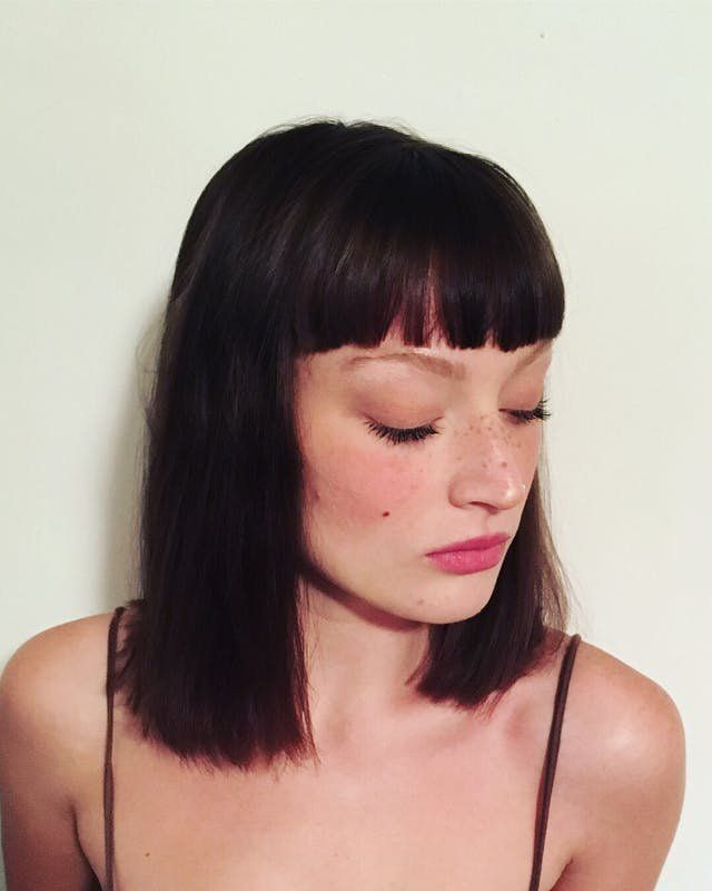 Frame your face beautifully with blunt bangs + shoulder-length locks.