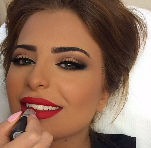 Browns and nude eyeshadow shades with a red lip as the focal point for a balance...