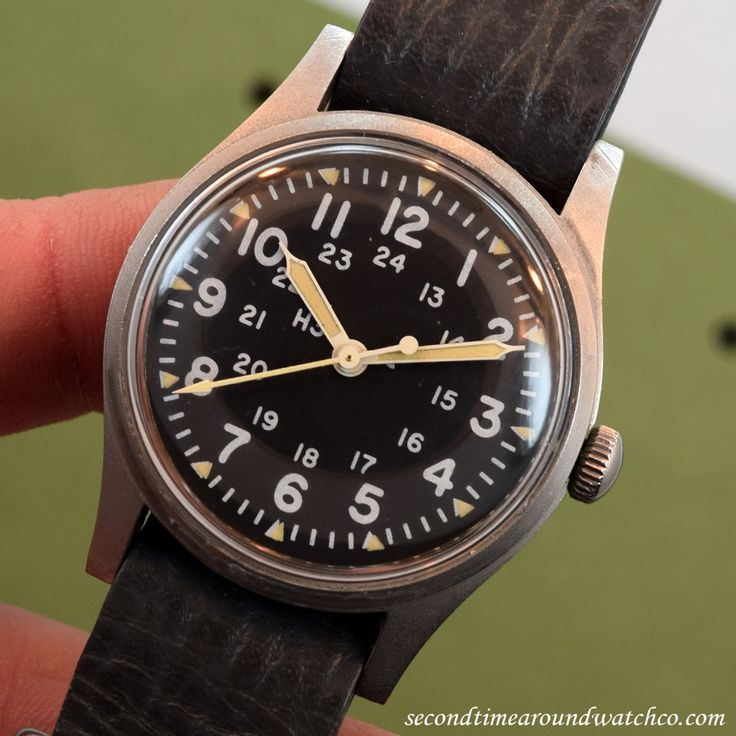 A 1982 Hamilton Military Steel timepiece with a black dial with painted, white...
