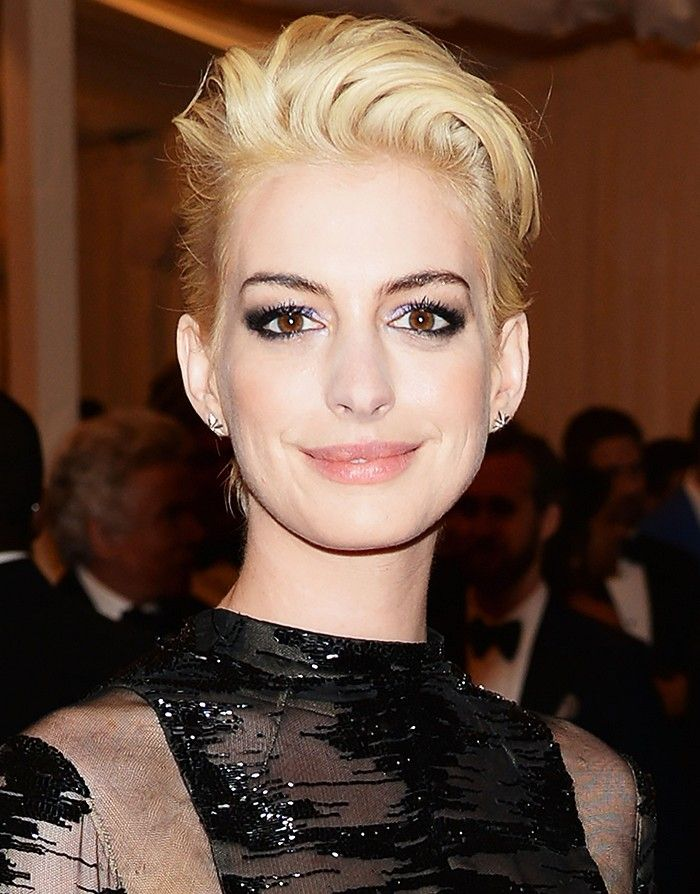 Anne Hathaway at the 2013 Met Ball rocking a platinum blonde rocker 'do with...