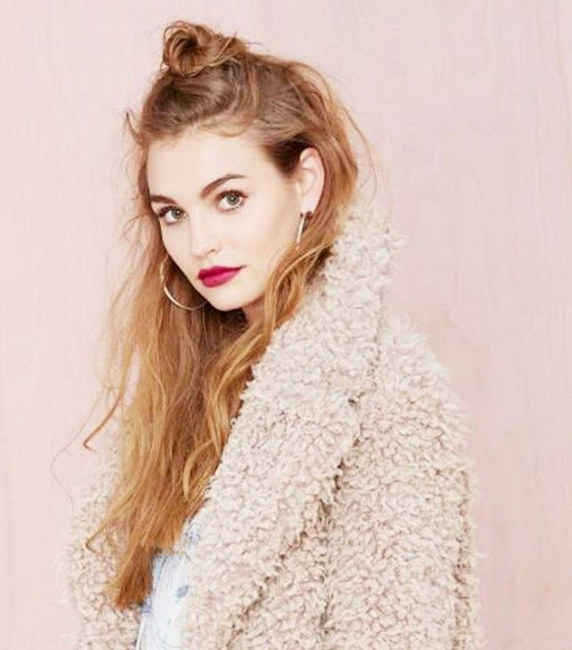 The messy half bun  1. Gather the hair above your ears into a high ponytail at t...