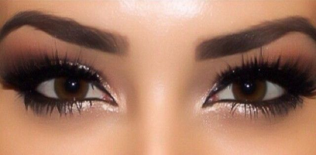 Fall Makeup: Smoky eyes using dark brown eye shadow and shimmery white for inner...