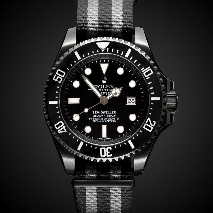 Great take on the classic Rolex. Black and canvas. Perfect with some Converse an...