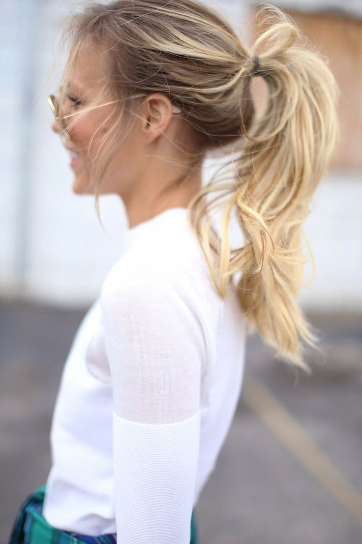 A loose, tousled ponytail looks effortlessly cool.