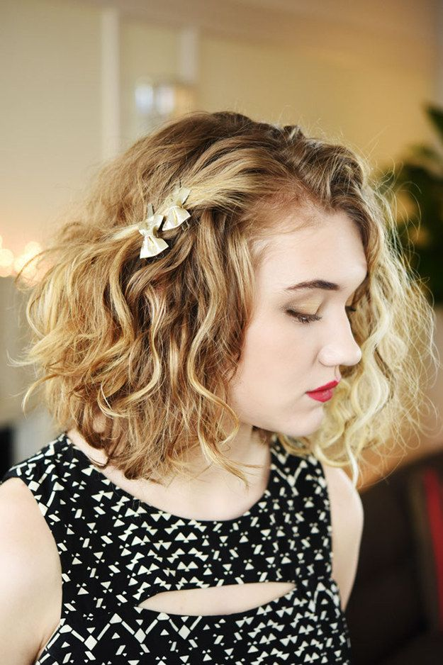 Curly bob topped with sweet bow clips