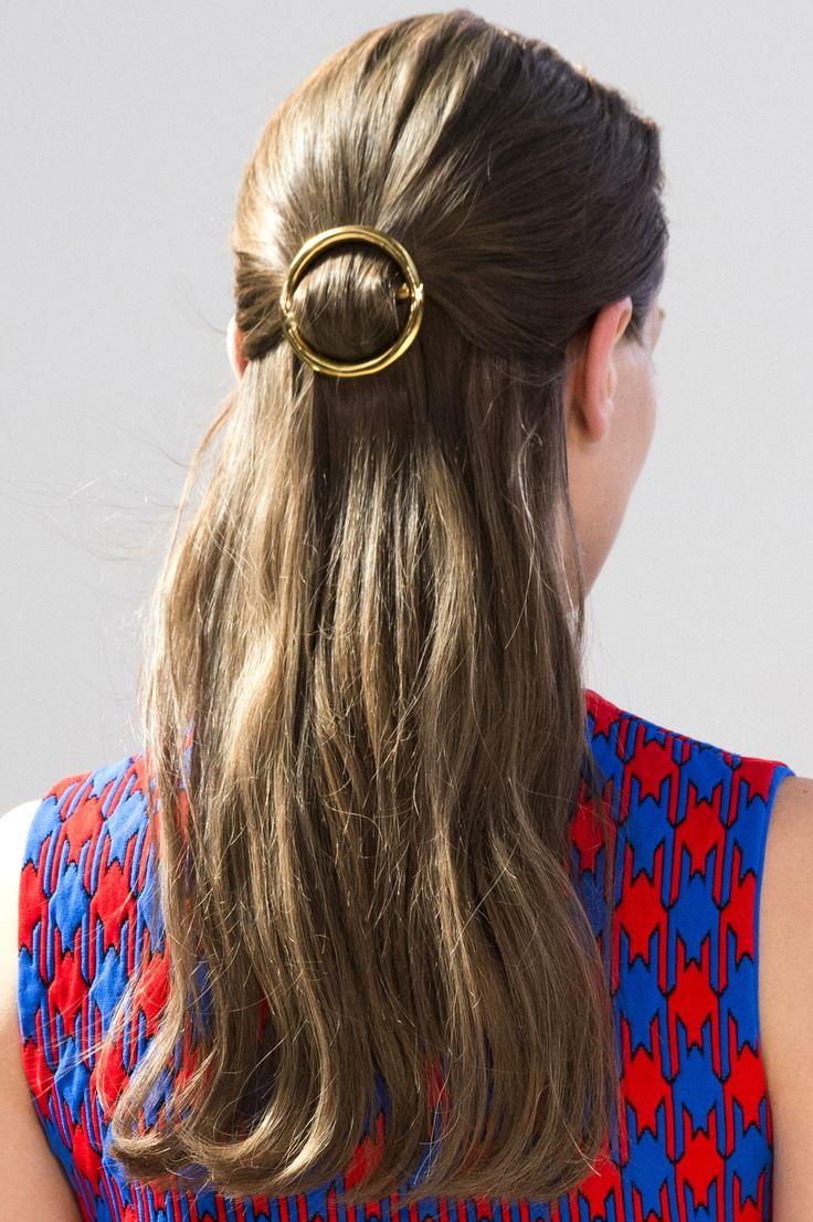 Dress up a simple half-up 'do with a gold hair clip