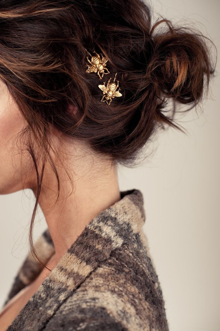 Opt for a messy bun embellished with unique bobby pins.
