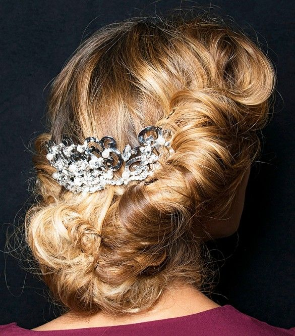 Secure a deep side part or half-pony with a smaller brooch or barrette (a la Cé...