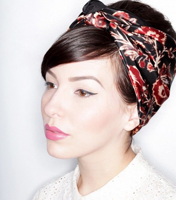 Why not add some retro flair to your look with a sleek silk scarf and major volu...