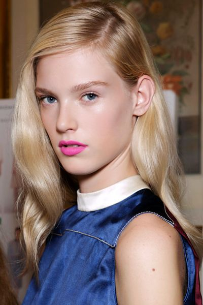 polished side part hairstyle