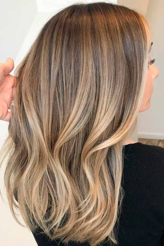 Light and dark brown hair with highlights and lowlights looks spectacular. Disco...