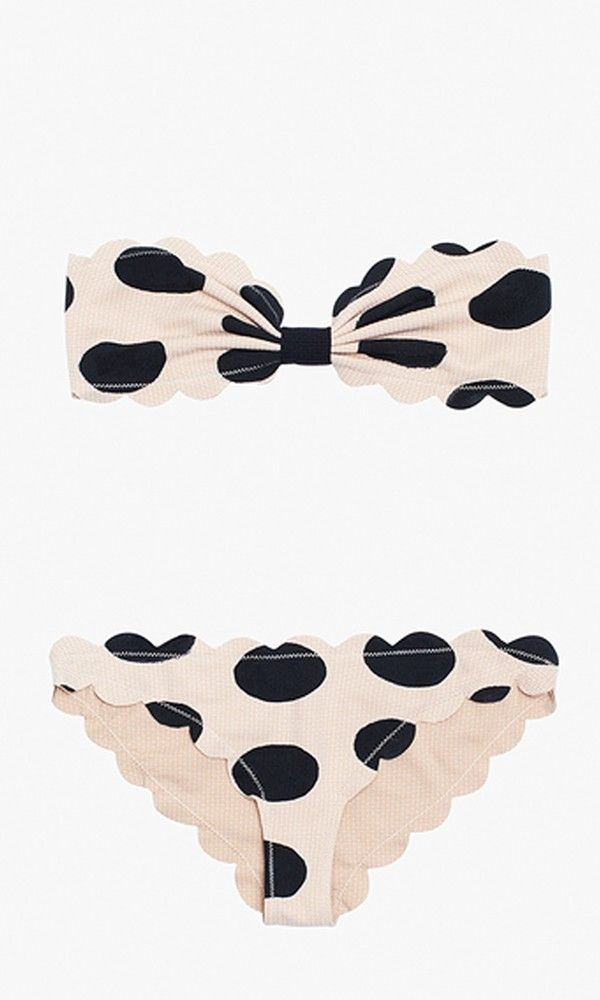 Flirty polka dots, basket-weave texture and a scalloped raw edge make this hand-...