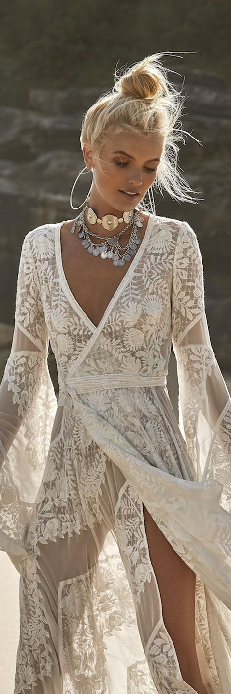 Boho lace style beach dress. This is super stunning! We love the wrap around sty...