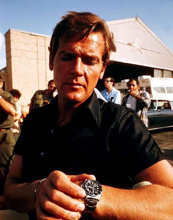 Roger Moore wearing a Rolex 1680 red Submariner on the set of The Man With The G...