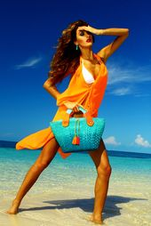 Play up the perfect summer look with this bright orange cover-up that is a chic ...